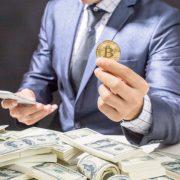 A man holding a coin